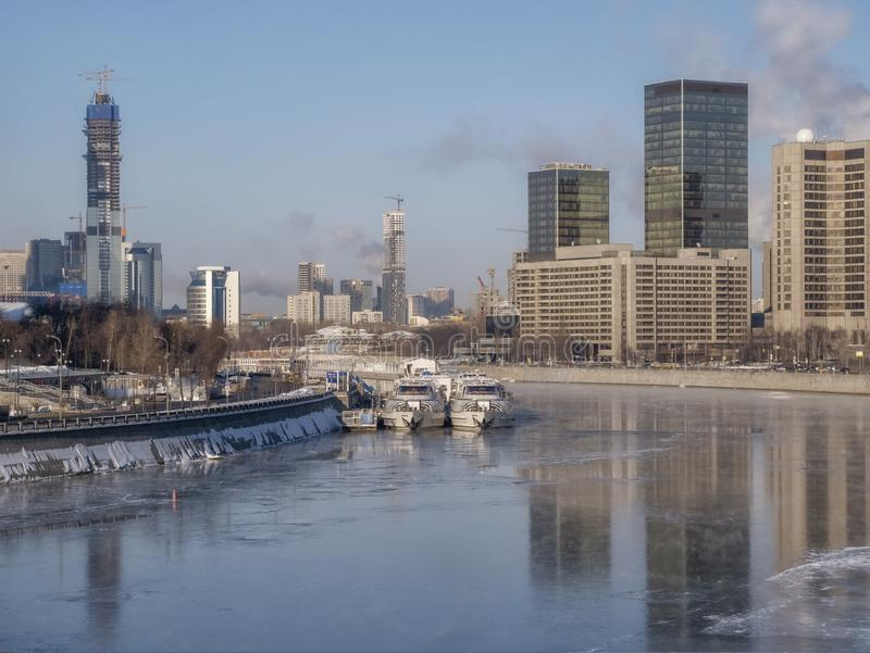 Moscow City is a commercial district in central Moscow, Russia on the Presnenskaya Embankment. City landscape with Moskva River stock photos
