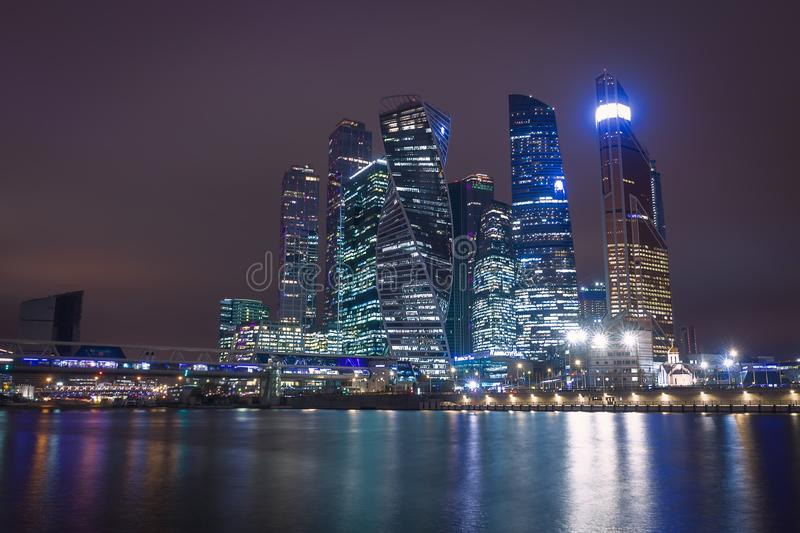 Moscow city night view with skyscrapers and a futuristic bridge. Over the river royalty free stock images