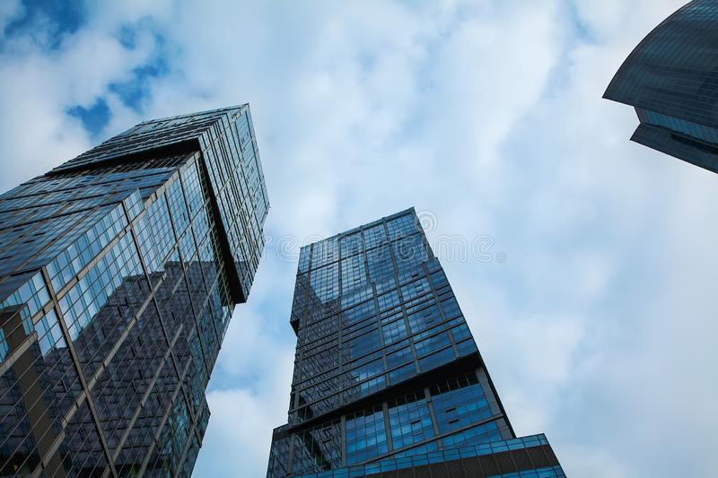 Moscow city Russia 08/07/2019.View of the top of modern glass skyscrapers against the blue sky. royalty free stock images