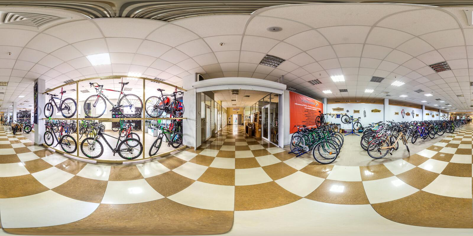Moscow-2018: 3D spherical panorama with 360 degree viewing angle of empty interior of bicycle store with a lot of bike. Full equir. Moscow-2018: 3D spherical royalty free stock photos