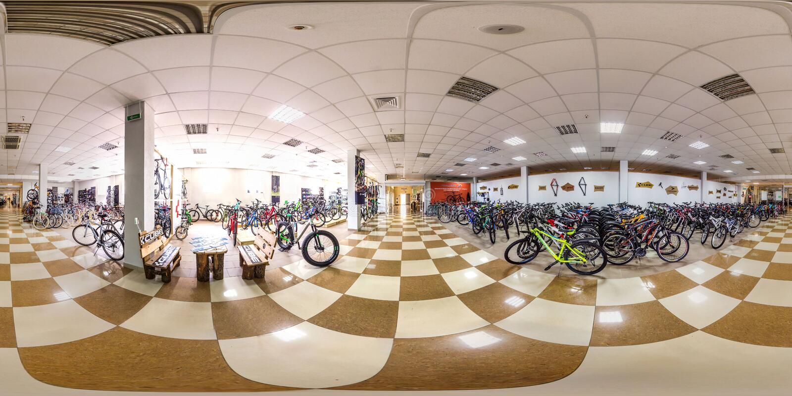 Moscow-2018: 3D spherical panorama with 360 degree viewing angle of empty interior of bicycle store with a lot of bike. Full equir. Moscow-2018: 3D spherical royalty free stock photography