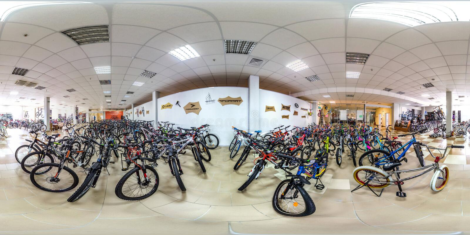 Moscow-2018: 3D spherical panorama with 360 degree viewing angle of empty interior of bicycle store with a lot of bike. Full equir. Moscow-2018: 3D spherical royalty free stock images