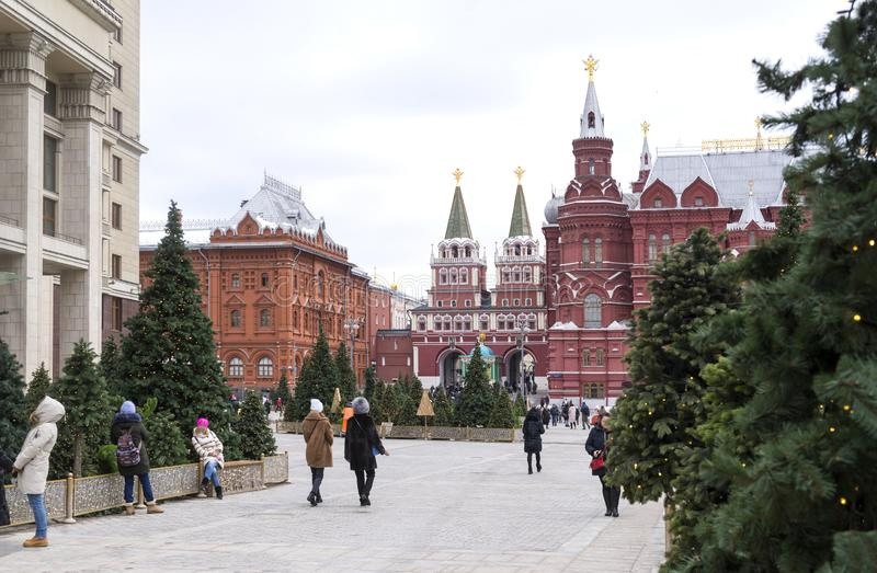 Moscow, the entrance to the red square in the winter spruce trees, people walk down the street royalty free stock photography