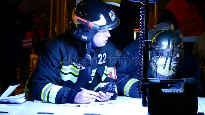 Staff of Russian rescue service at the command point stock photos