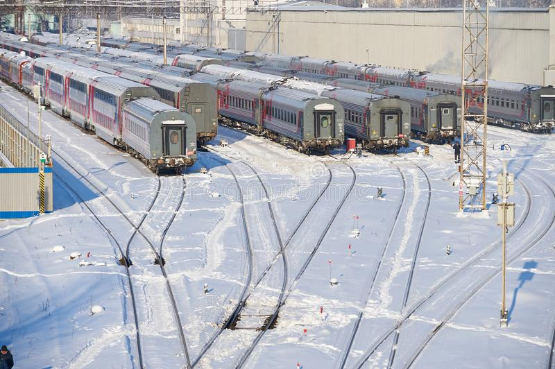 MOSCOW, FEB. 01, 2018: Winter view on railway passenger coaches cars at rail way depot under snow. Passenger trains coaches cars i royalty free stock photography