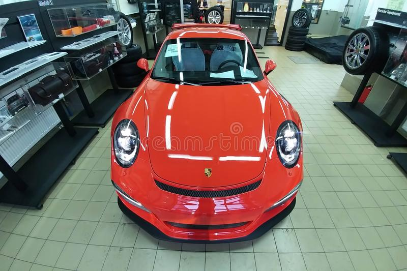 Moscow. February 2019. A new orange metallic Porsche 911 GT3 RS in an interactive dealership maintenance box. Public open area of. Service center stock images