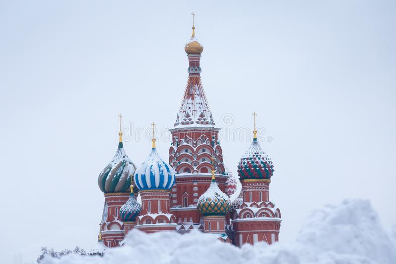 Saint Basil`s Cathedral domes after great winter snowfall, Moscow, Russia stock images