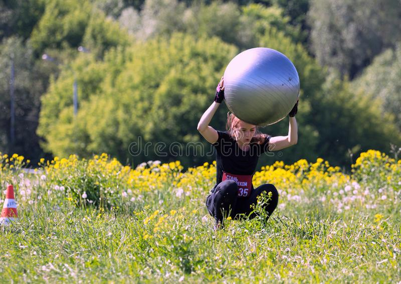 Moscow festival of fitness. A woman jumping with a ball. 2018.06.26, Moscow, Russia. Moscow festival of fitness. A woman jumping with a ball stock photography