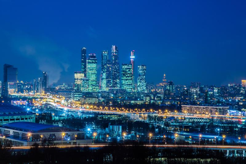 Moscow international business center `Moscow-city». Night or evening cityscape. Blue sky and street lights. Urban architecture stock photography