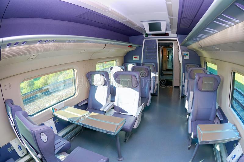 MOSCOW, JUL,12, 2010: Fish eye shot of high speed train Interior saloon inside, passenger seats, tables for train passengers royalty free stock images