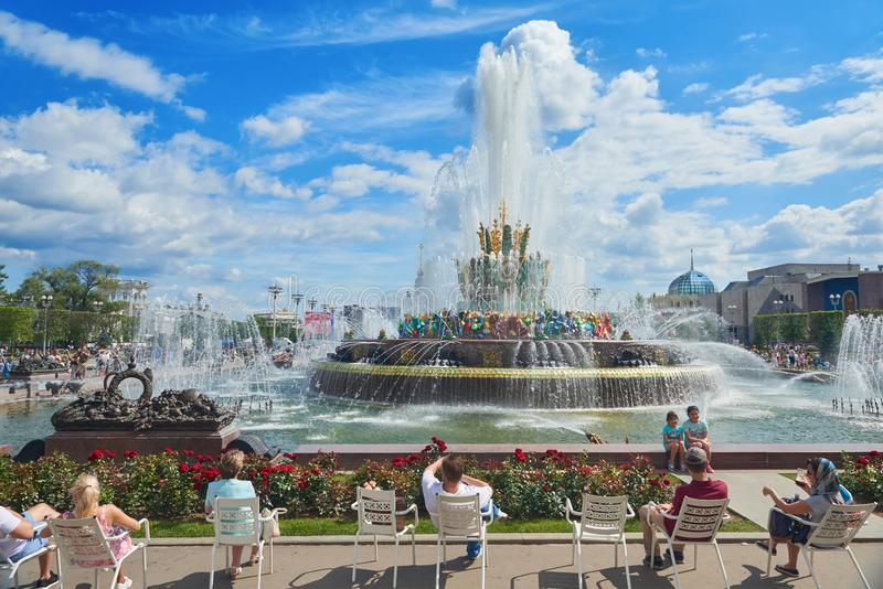 MOSCOW, JUL. 28, 2019: VDNKh fountain Stone Flower decorated with precious stones and metal sculptures. Peope in the chairs are ha stock photo