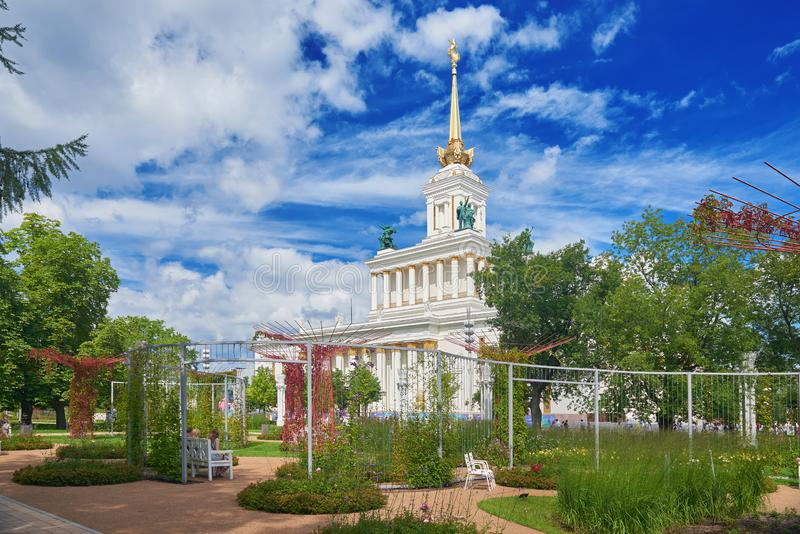 MOSCOW, JUL. 28, 2019: View on VDNKh central pavilion. USSR Stalinist empire style white building with soviet golden elements, col royalty free stock photography