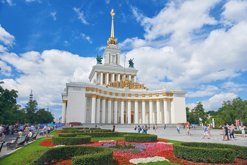MOSCOW, JUL. 28, 2019: View on VDNKh central pavilion. USSR Stalinist empire style white building with traditional soviet golden e stock photos