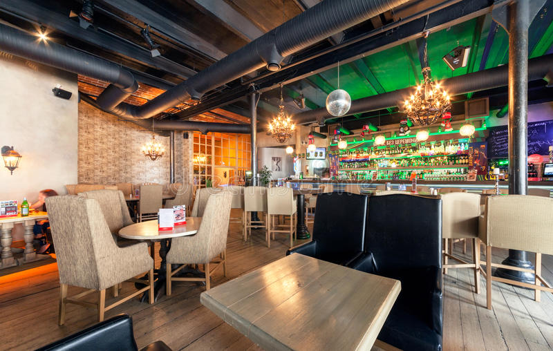 MOSCOW - JULY 2014: Interior of the modern pub restaurant in fusion style - stock photos