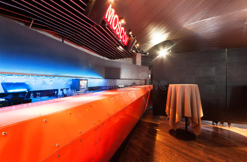 MOSCOW - JULY 2013: Interior of a modern restaurant SHAKTI TERRACE in the center of Moscow. The orange bar in the dance hall.  stock photography