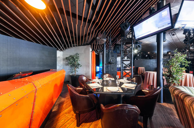 MOSCOW - JULY 2013: Interior of a modern restaurant SHAKTI TERRACE in the center of Moscow. The orange bar in the dance hall.  royalty free stock photo