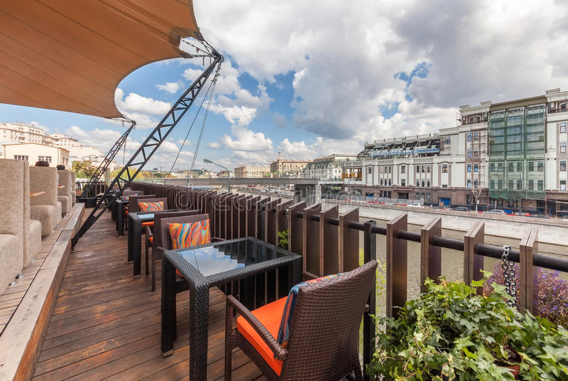 MOSCOW - JULY 2013: Interior of a summer terrace of the modern restaurant SHAKTI TERRACE overlooking the center of Moscow.  royalty free stock image