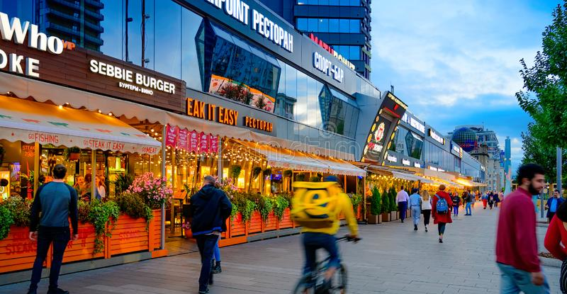Moscow - July 20, 2019: People Walk on New Arbat Avenue in evening twilight. Moscow - July 20, 2019: People Walk in evening twilight on New Arbat Avenue royalty free stock image