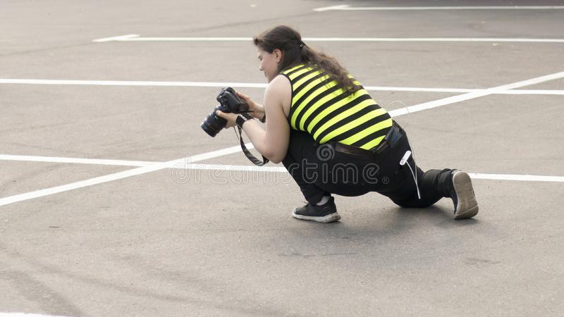 A female photographer with DSLR camera stock images