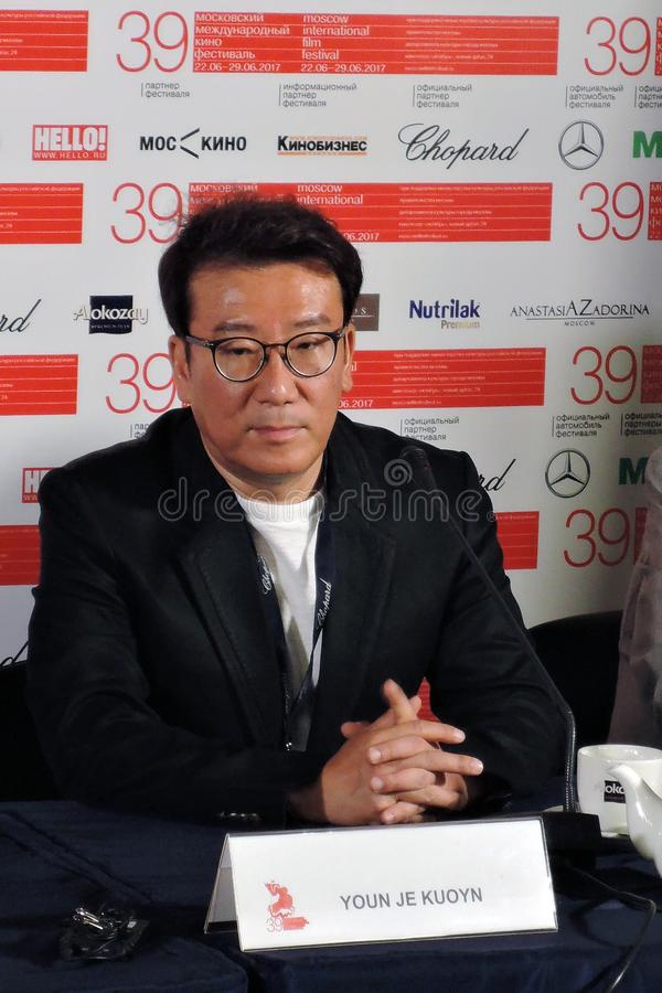 Film director and producer Youn Je Kuoyn. MOSCOW - JUNE 25, 2016: Film director and producer Youn Je Kuoyn South Korea gives a press-conference at 39th Moscow stock images