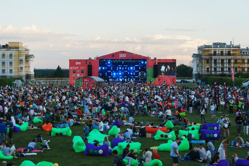 Moscow, June 3, 2018 - the main stage of the music festival `Usadba Jazz`. Modern young people listen to music on the lawn in the park during a musical stock photo