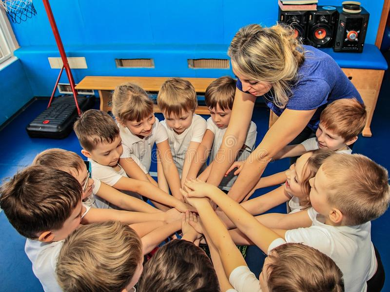 02.03.2017 Moscow kindergarten. Children with a coach involved in sports. Children up to seven years with a coach are set to play before a sports competition royalty free stock photos
