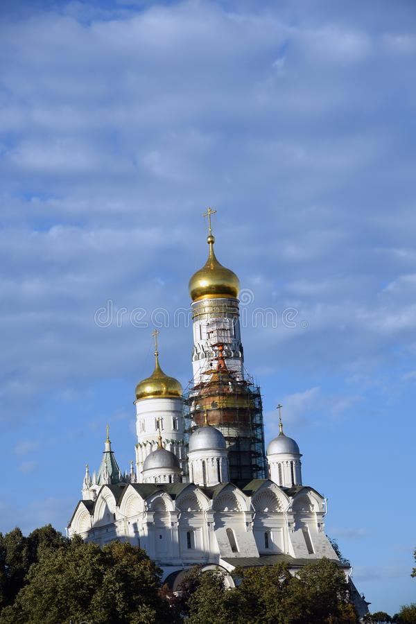 Moscow Kremlin churches. Color photo. Moscow Kremlin churches. Blue sky background. UNESCO World Heritage Site. Color photo stock photography