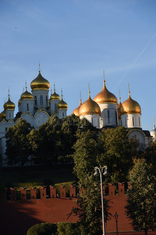 Moscow Kremlin churches. Color photo. Moscow Kremlin churches. Blue sky background. UNESCO World Heritage Site. Color photo royalty free stock images