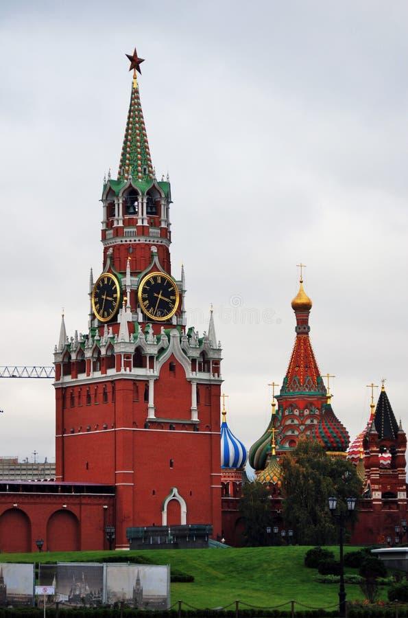 Moscow Kremlin. Color photo. Spasskaya tower and Saint Basil church. stock photography