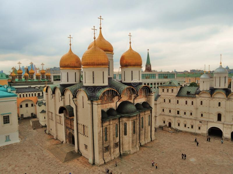 Moscow Kremlin. Dormition cathedral. Color photo. Moscow Kremlin. Dormition cathedral and Sobornaya Square. Birds eye view. UNESCO World Heritage Site. Color royalty free stock photo