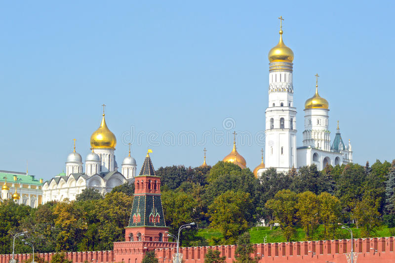 The Moscow Kremlin The ensemble of the Kremlin bell towers. The Moscow Kremlin Sunlight Day Russia The ensemble of the Kremlin bell towers stock photos