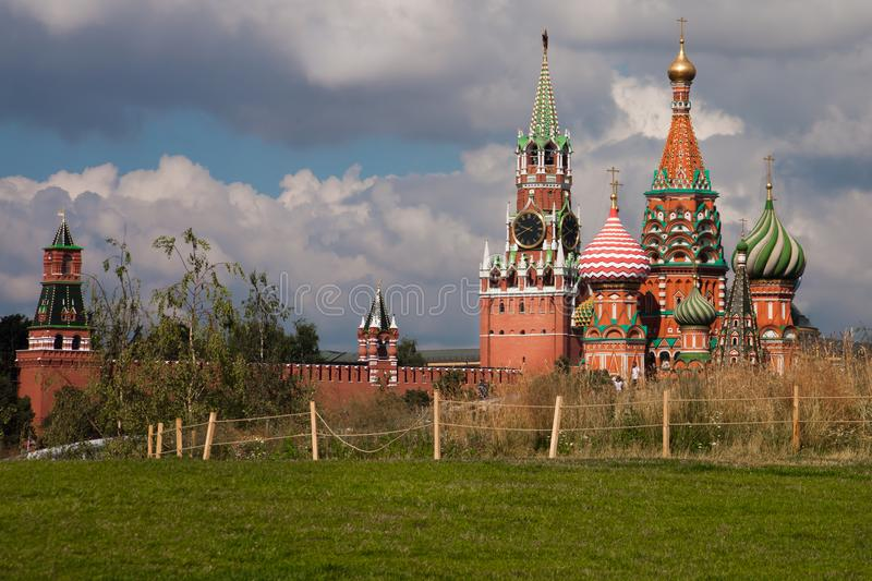 Moscow Kremlin and the green field in front of it. Birches grow. The Moscow Kremlin and the green field in front of it. Birches grow between the field and the stock photo