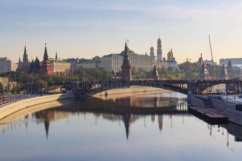 Moscow Kremlin on a Moskva river embankments background. View from Patriarshiy bridge in sunny spring morning stock image
