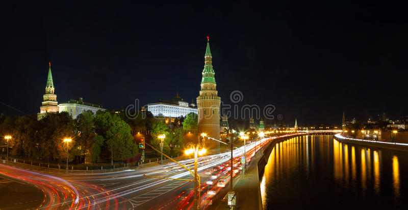 The Moscow Kremlin at night. Evening traffic along the Kremlin Embankment in Moscow stock photography