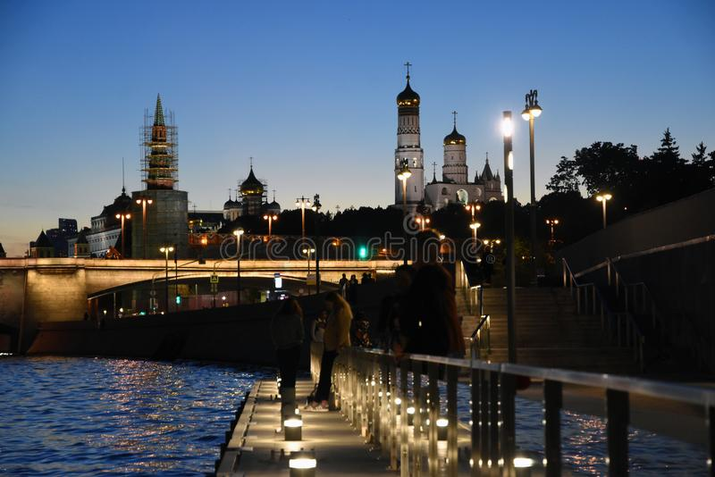 Moscow Kremlin and other Moscow city landmarks at night. Color photo with people stock images