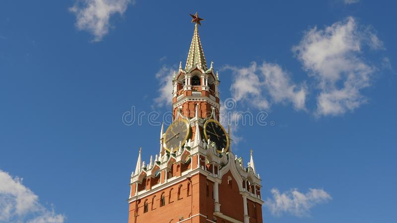 Moscow Kremlin, Red Square. Spasskaya Tower and clock decorated by the ruby star on the top of it. Blue sky background. Moscow Kremlin, Red Square. Spasskaya royalty free stock photography