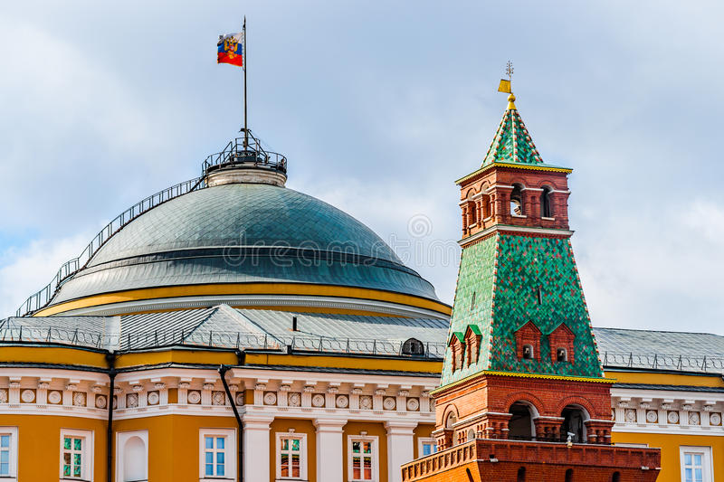 Moscow Kremlin Senate building and Senate tower. The President of the Russian Federation standard over the green dome. Senate tower of the Kremlin wall (front stock photo