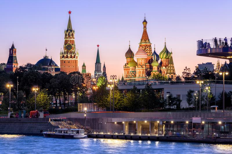 Moscow Kremlin and St Basil`s Cathedral at night, Russia. Zaryadye Park on embankment of Moskva River. Beautiful panorama of the Moscow city center at dusk stock images