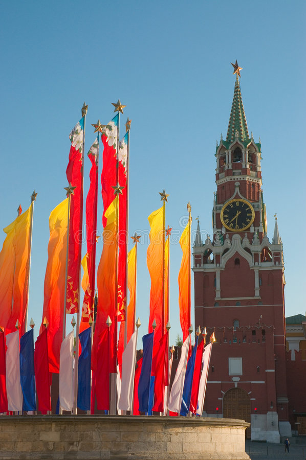 Moscow Kremlin tower and flags royalty free stock photo