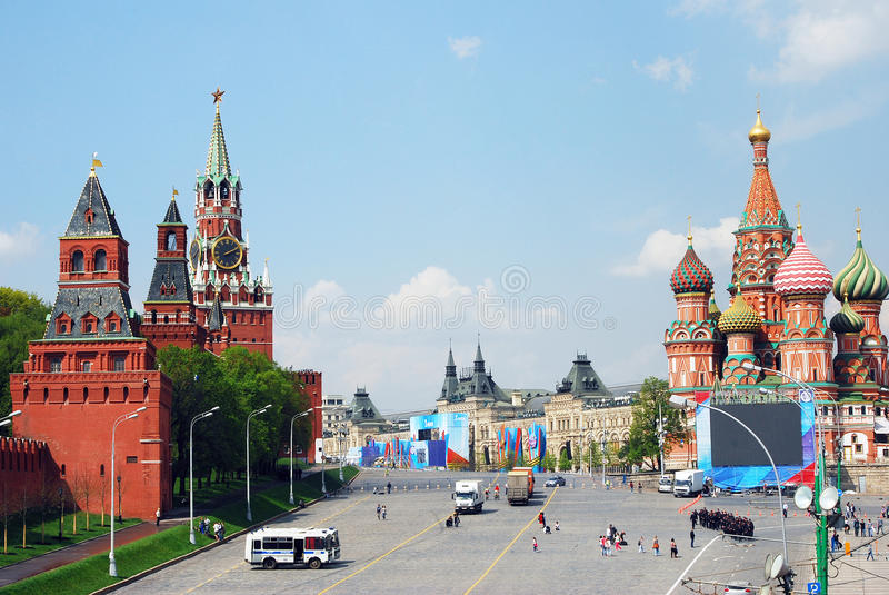 Moscow Kremlin towers and Saint Basils Church. View of Vasilevsky descent leading to the Red Square in Moscow decorated for Spring and Labor Day (May Day) stock image
