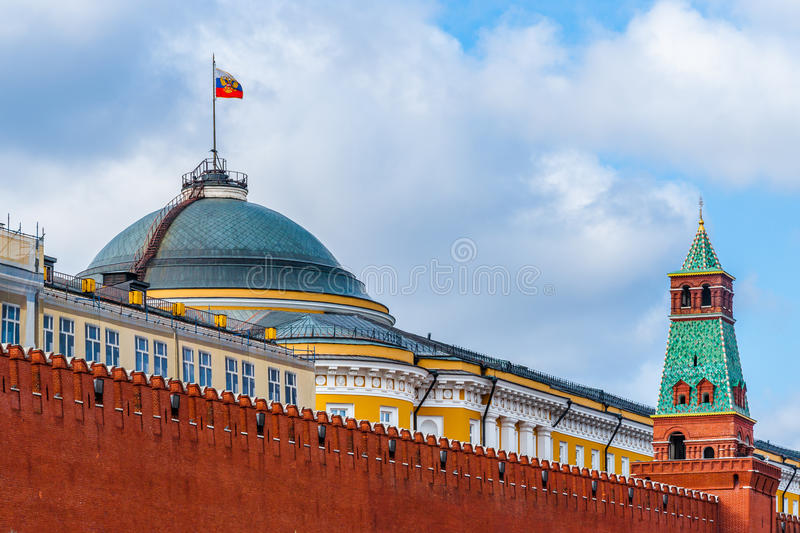 Moscow Kremlin wall Senate building and tower. Red Moscow Kremlin wall, Senate building with the President of the Russian Federation standard over the dome royalty free stock image
