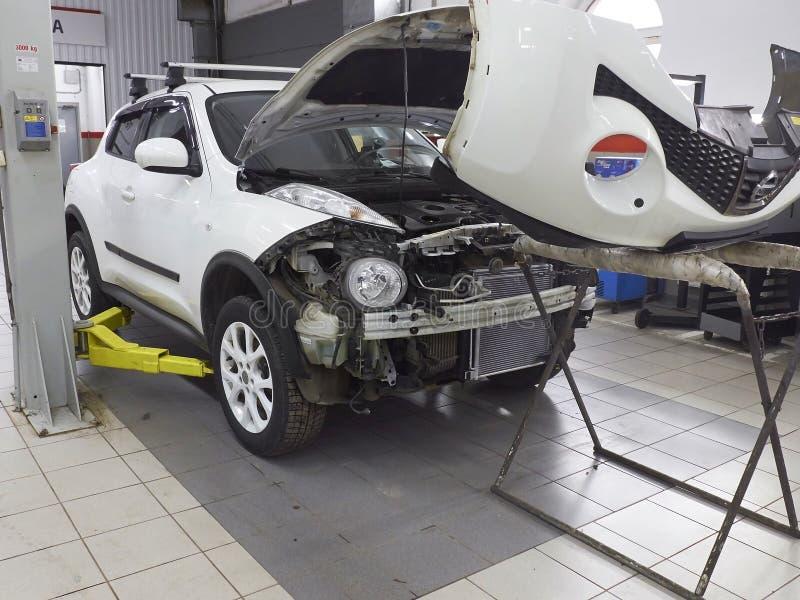MOSCOW, MAR,02, 2017: Car automobile maintenance works repair MOT at automotive service center workshop. Engine repair maintenance. Car bodyshell repair stock image