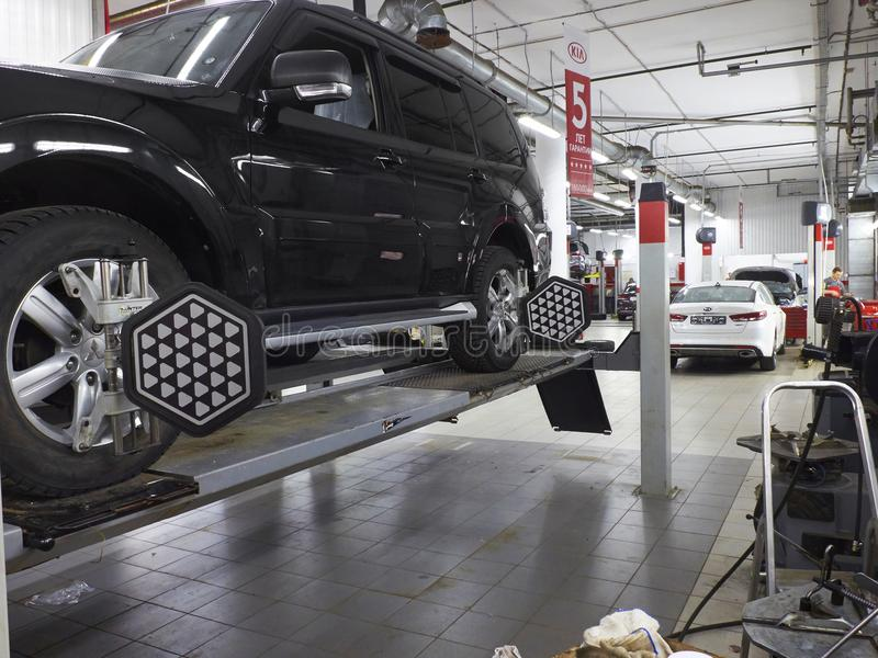MOSCOW, MAR,02, 2017: Car automobile wheel alignment maintenance works repair at automotive service center workshop. Technical mai. Ntenance wheel alignment royalty free stock images