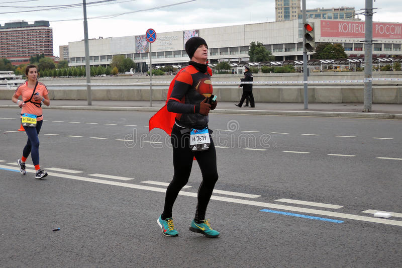 Moscow Marathon. Runner man in black and red costume stock photos