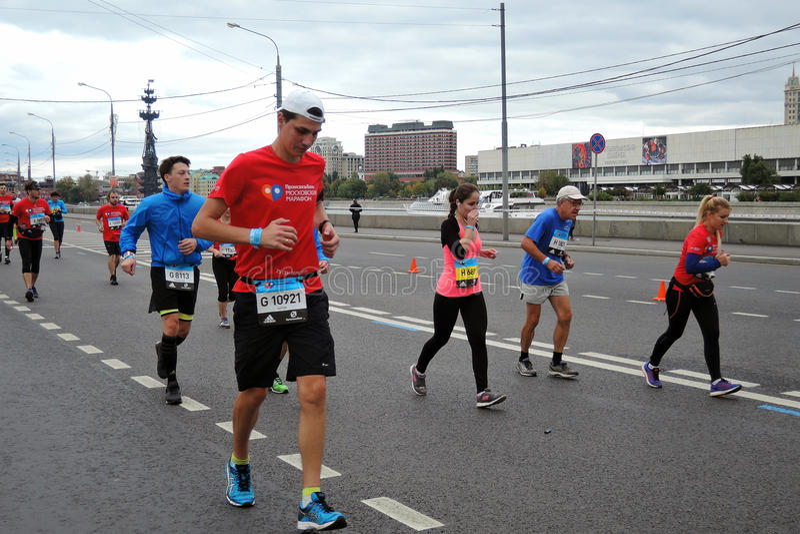 Moscow Marathon runners, men and women stock image