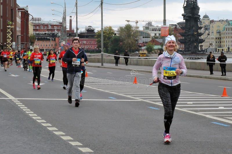 Moscow Marathon runners, men and women stock photos