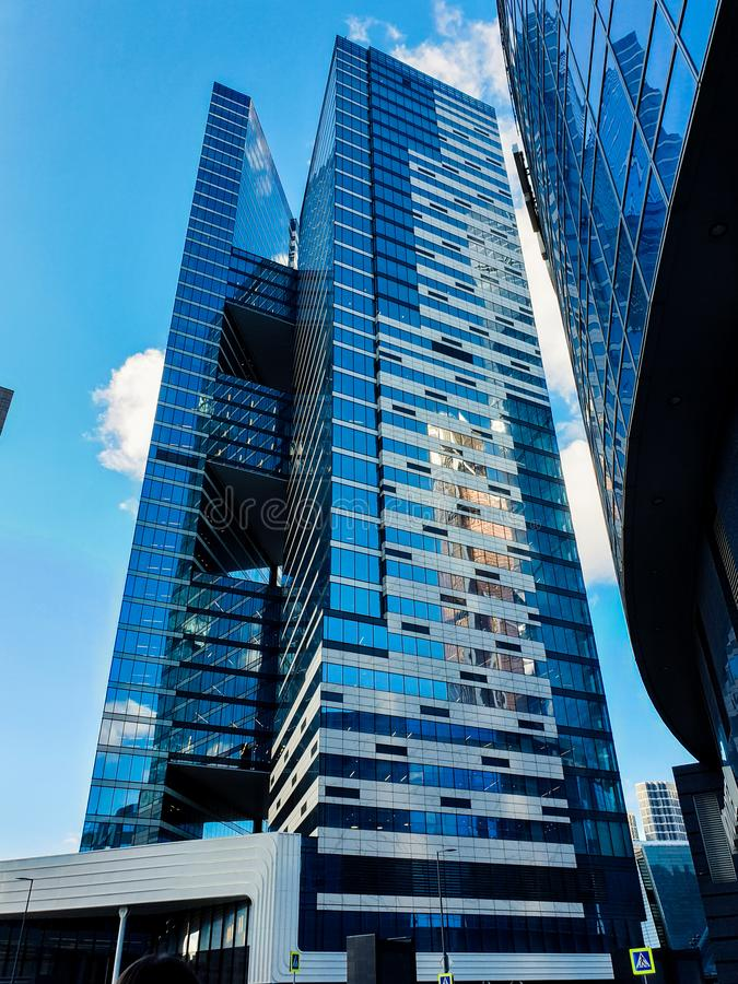Moscow - March 25, 2019: Bottom view of one of the Moscow City skyscrapers with an unusual design against royalty free stock photography