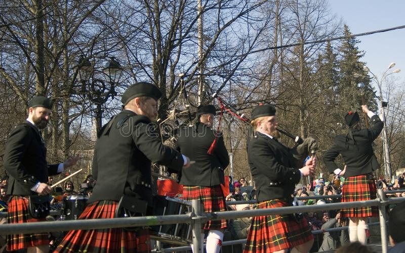 City Pipes. A piper band performing at Saint Patrick`s Day celebration stock image