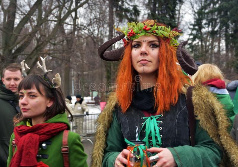 Saint Patrick`s Day celebration in Moscow. A woman in carnival costume royalty free stock photo