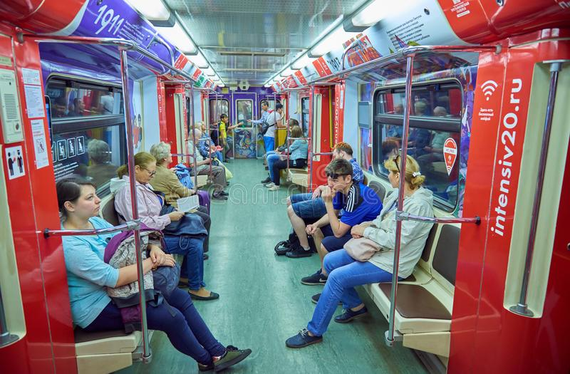 MOSCOW, MAY, 13, 2018: Different people traveling in russian modern subway passenger train. Mass transit metro electric transport. Passengers in the train royalty free stock photography